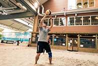 Beachvolleyboll och burgare