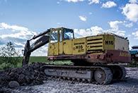 Kör grävmaskin för tre